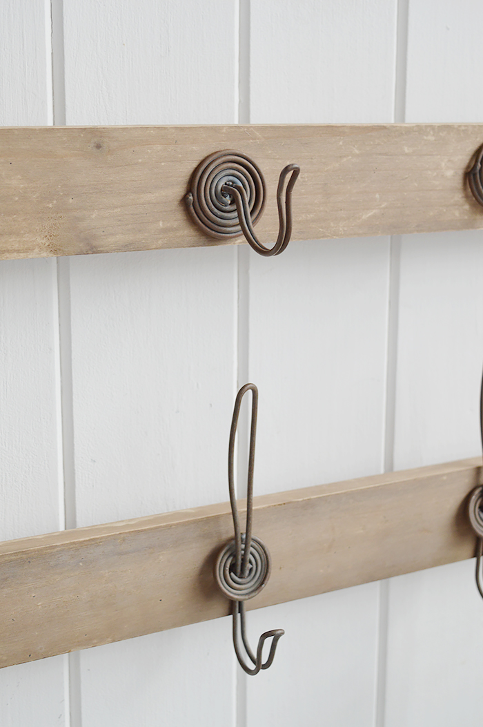 Pawtucket wooden wall shelf with hooks in greyed wood for the living room, bathroom, hallway or bedroom. Perfectly complements coastal, country and white furniture in New England Interiors and homes from The White Lighthouse. Close image of hooks