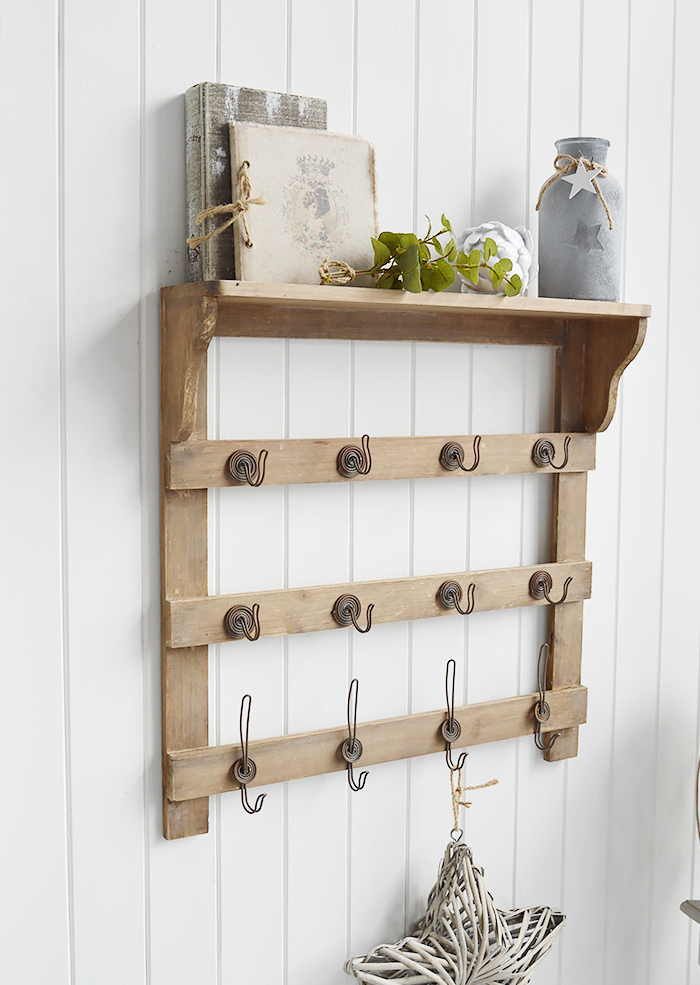 Pawtucket wooden wall shelf with hooks in greyed wood for the living room, bathroom, hallway or bedroom. Perfectly complements coastal, country and white furniture in New England Interiors and homes from The White Lighthouse, ideal for coat storage
