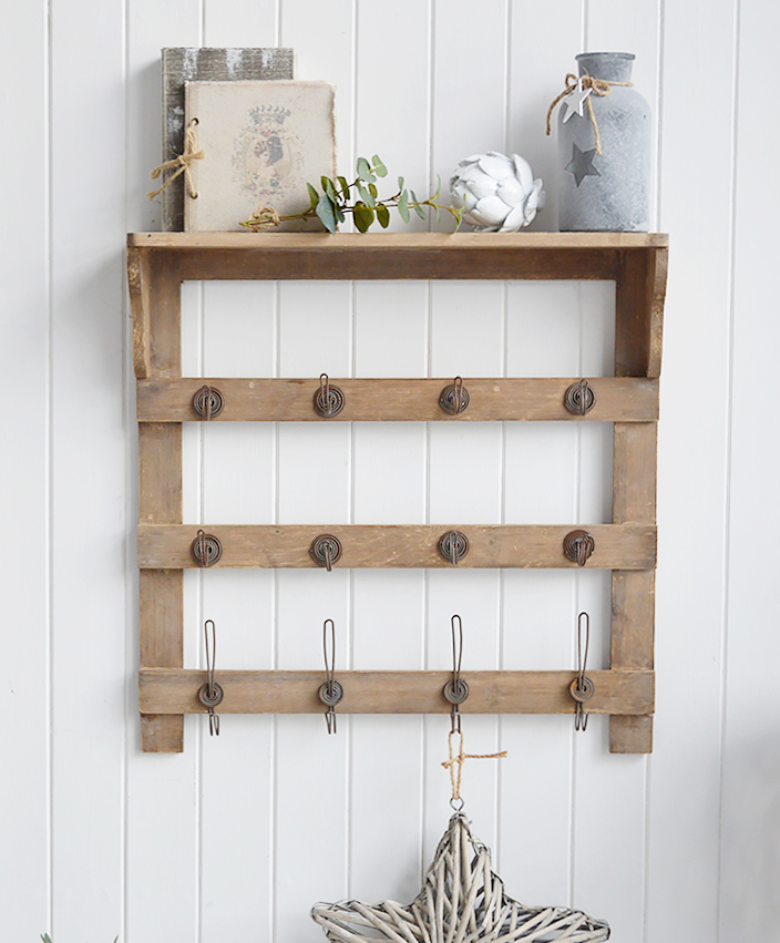 Pawtucket wooden wall shelf with hooks in greyed wood for the living room, bathroom, hall or bedroom. Perfectly complements coastal, country and white furniture in New England Interiors and homes from The White Lighthouse
