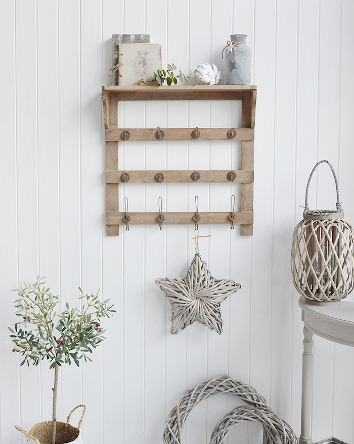 Pawtucket wooden wall shelf with hooks in greyed wood for the living room, bathroom, hallway or bedroom. Perfectly complements coastal, country and white furniture in New England Interiors and homes from The White Lighthouse