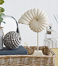 Decorative shell on a stand from The White Lighthouse New England furniture and home decor Interiors