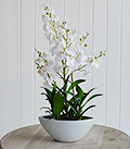 Large arrangement of artificial white orchids