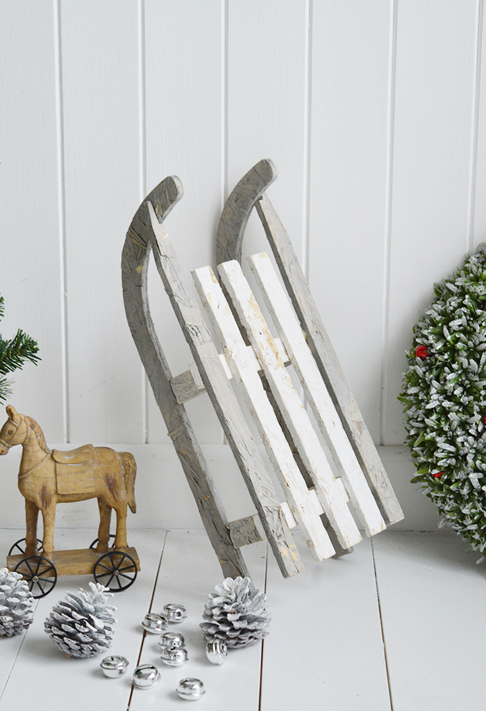 A gorgeous decorative wooden white and grey rustic sleigh for elegant Christmas decorations from The White Lighthouse Furniture in New England , Country Coastal and City home interiors and furniture