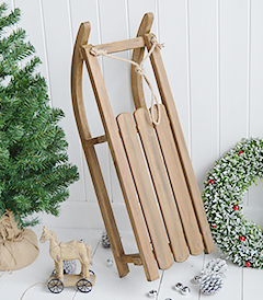 A gorgeous decorative wooden sleigh for elegant Christmas decorations. An absolutely beautiful festive decoration in such a timeless style that will last for many years to come, creating many magical memories from The White Lighthouse Furniture in New England , Country Coastal and City home interiors and furniture