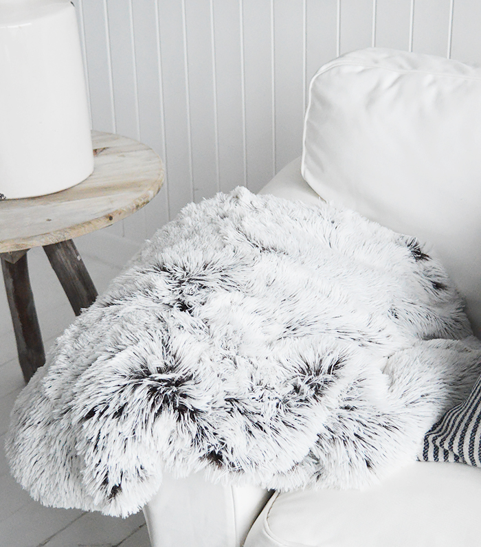 Luxurious cosy grey fur throw from The White Lighthouse Furniture