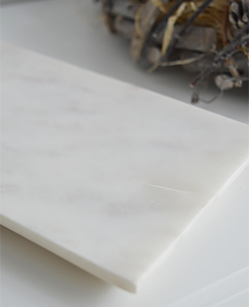 White marble tray, perfect for straighteners to cool