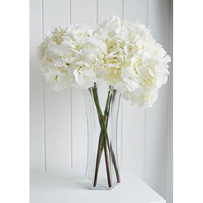 This is a very realistic and gorgeous looking stem of white Hydrangea, bunched together they are absoultely fabulous and will save you a small fortune as they last for years!