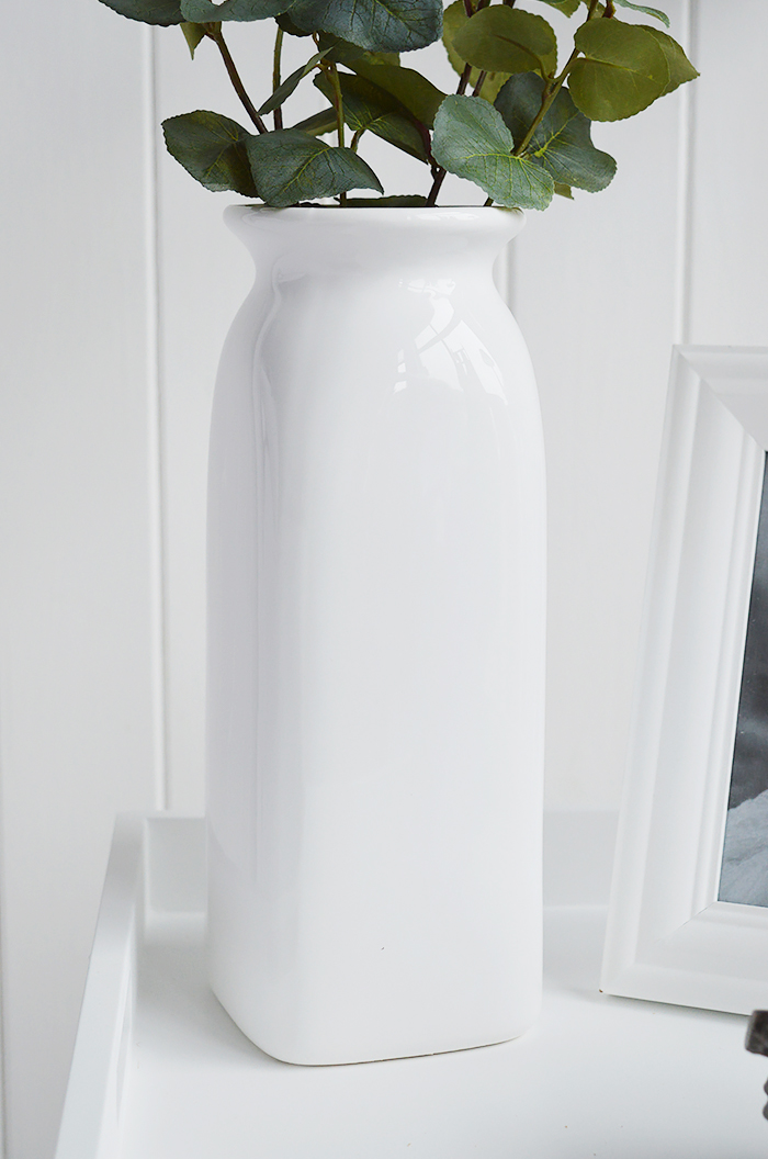 A white ceramic tall vase in simple designed to perfectly complement our New England Coastal and Country home interiors with our bedroom, living room anf hallway white furniture