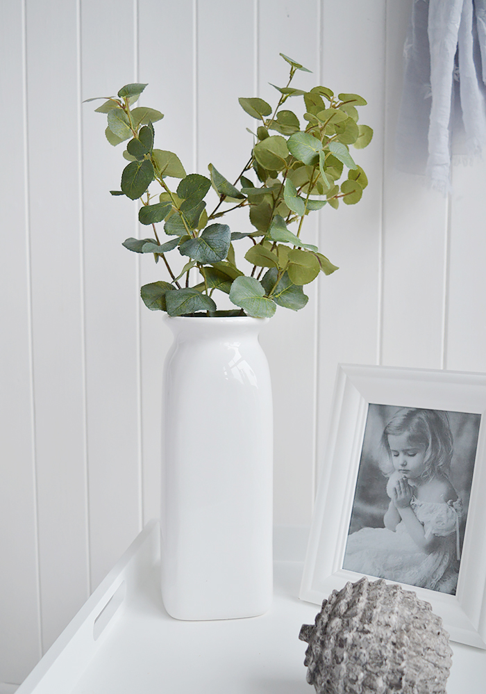 A white ceramic tall vase in simple designed to perfectly complement our New England Coastal and Country home interiors with our bedroom, living room anf hallway white furniture from The White Lighthouse