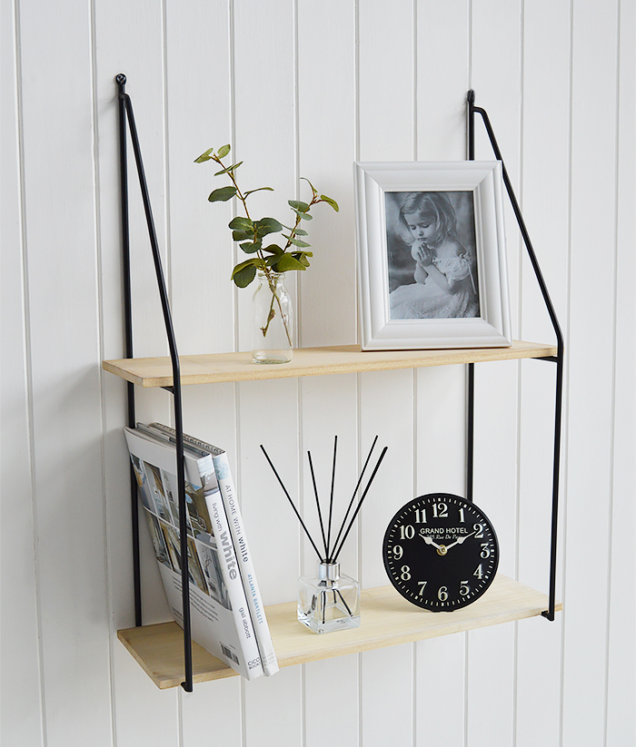Boston Bohemian Industrial Wall Shelf with 2 shelves. Pitcure shown in a living room with books, photo frames and a clock for wall decor