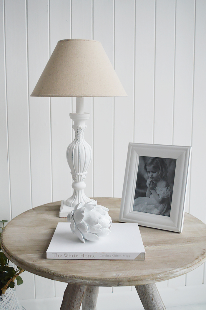 White wooden 5 x 7 photograph frame with white home decor accessories