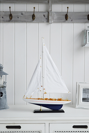 Blue and white wooden yacht for nautical home interiors