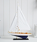 Decorative whit and blue wooden yacht for homes by the sea or coastal interior styling