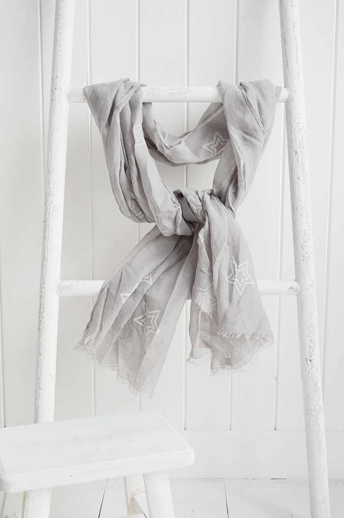 A grey scarf with white stars, from The White Lighthouse Furniture New England Lifestyle.