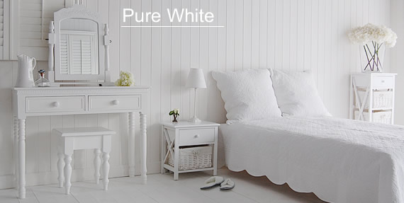 Pure white bedroom furniutre, calm in its purity and simplicity. Shows the white New England white dressing table, New Haven bedside and New Haven tall storage unit