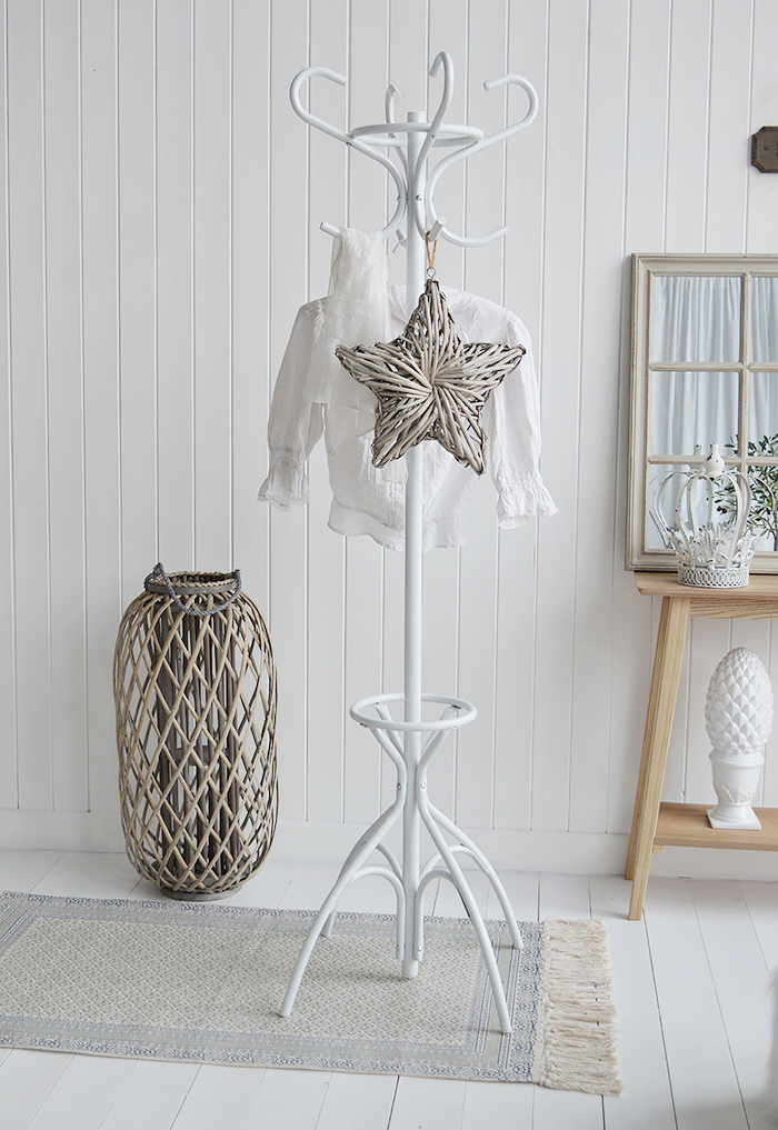 A white traditional hat and coat stand.  An essential piece of hallway furniture, the white metal coat rack and umbrella stand finished in white provides the perfect hall storage solution.  In a traditional Bentwood design this coat stand has four double hooks for hanging your hats, coats and scarves and base to store umbrellas and walking sticks.