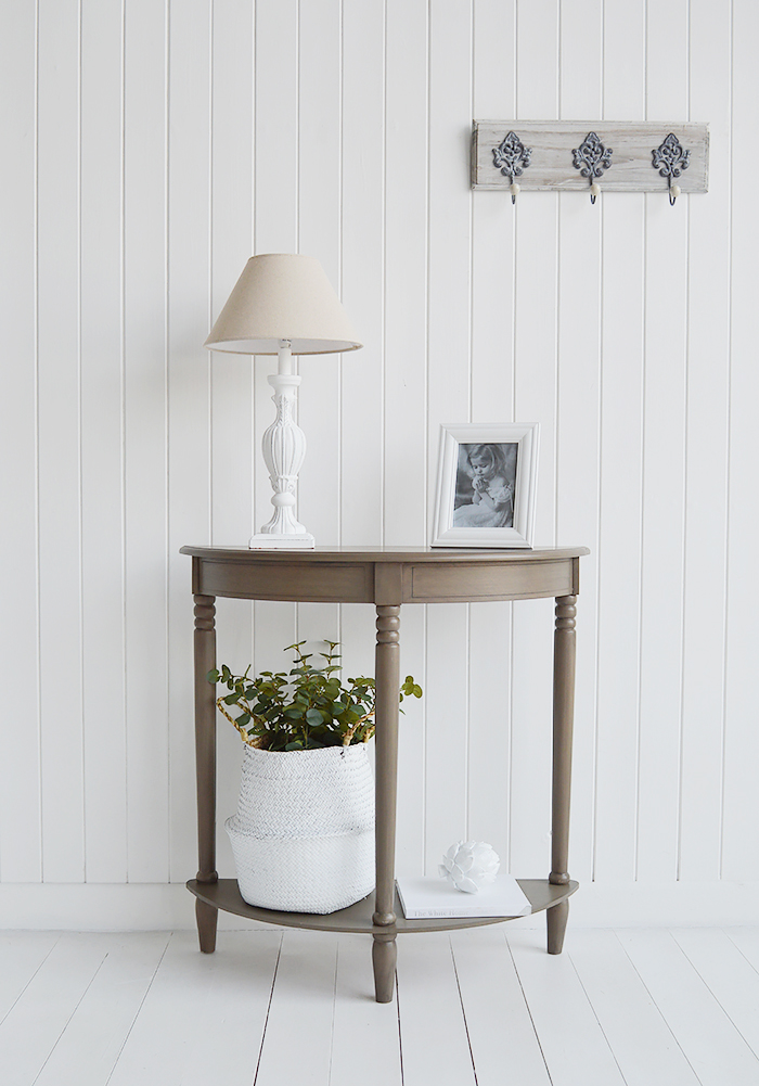 The French Grey narrow half moon console table, with a depth of 30 cm , a fabulous affordable option for decorating smaller spaces