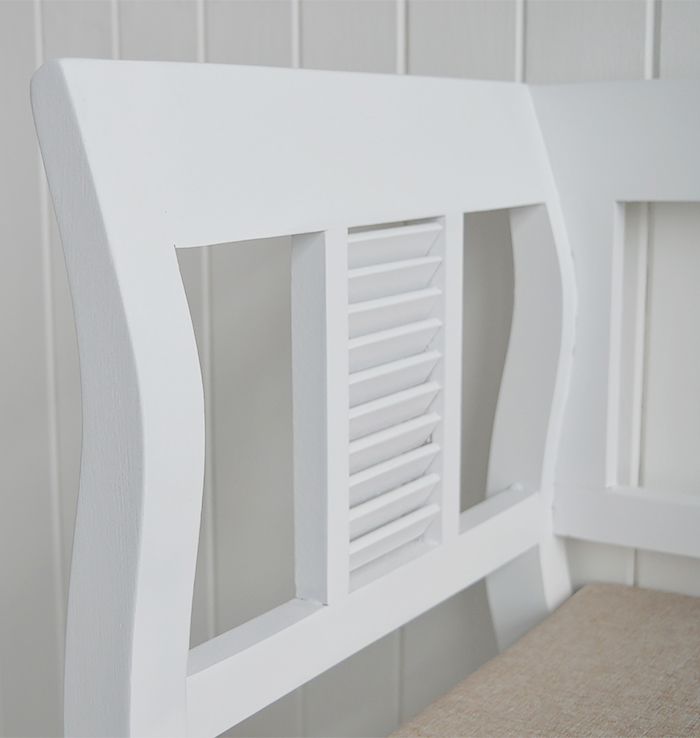 Close up of the finish of the Rhode Island white storage seat with high arms for a luxurious hallway storage bench and living room window seating
