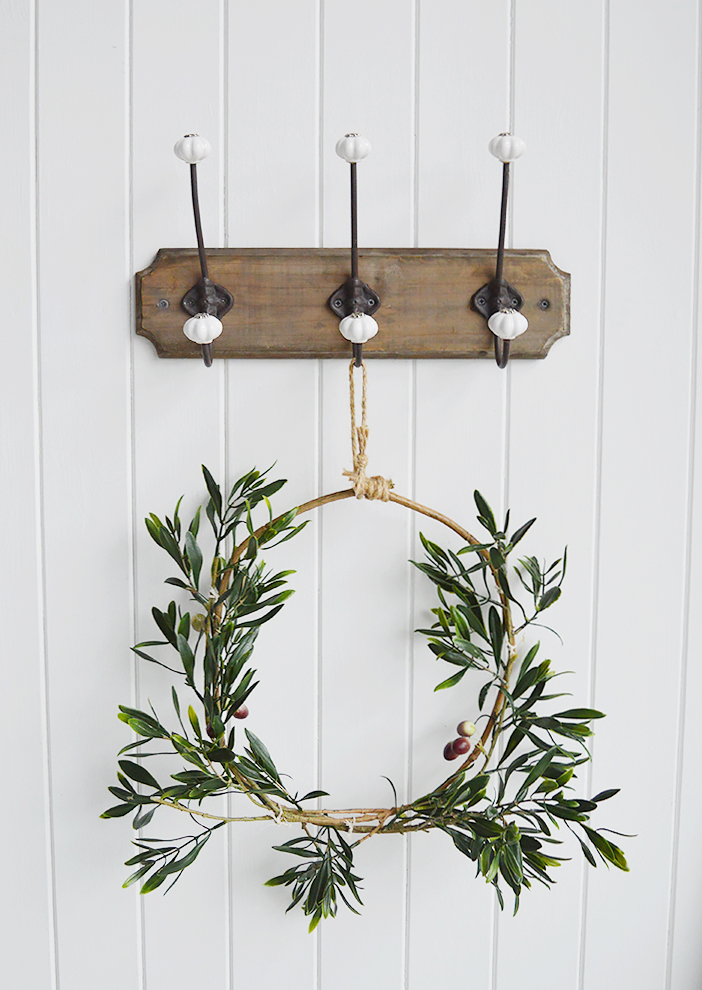 Two artificial olive brances tied together to form an olive wreath