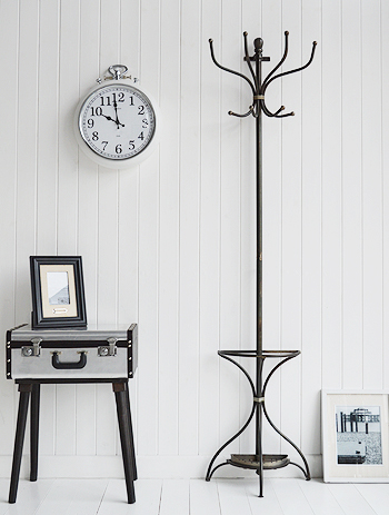 Wall mounted coat stand with a place for umbrellas, hockey stick and walking sticks