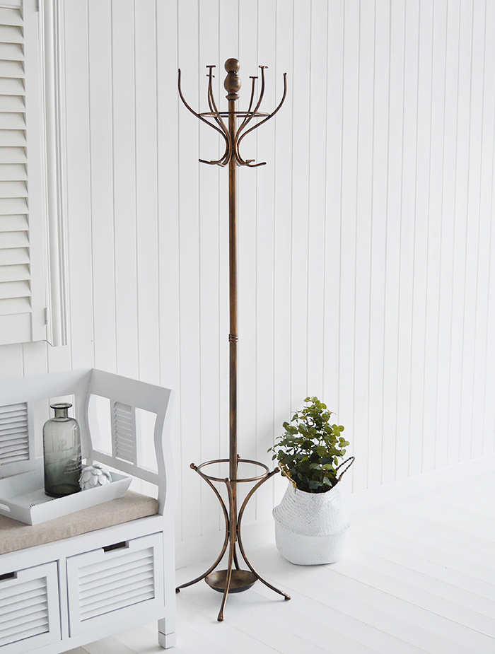 A traditional antiqued copper coloured coat stand for hallway furniture