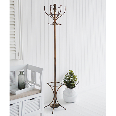 Copper coloured traditional bentwood metal coat stand with umbrella holder