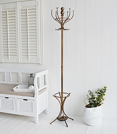 Traditional antiqued copper coloured metal coat stand for hallway coat storage