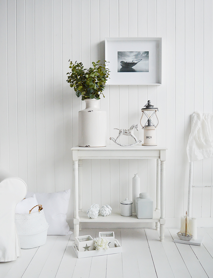 White furniture from The White LIghthouse. A colonial white console table with a shelf for hallway and living room furniture in New England, coastal, country and city homes