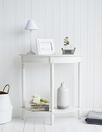 Simple white furniture. White Colonial Hall furniture, a half moon console table with a shelf, made perfectly to fit small hallways