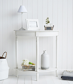 Colonial white furniture, a narrow half moon console table with a shelf