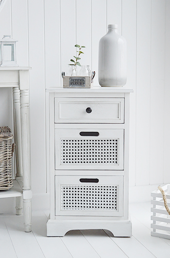 A small chest of drawers as a lamp table for great hall storage. A laid back colonial style of furniture for a light and airy interior. Finished in a aged white paint with woven rattan drawer fronts and a slight distressing, The British Colonial range creates a sophisticated space with a touch of formality for white hallway furniture.