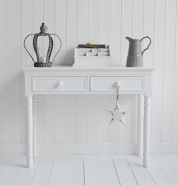 Bring simplicity into your hall and living room interior with the classic New England white console table with drawers