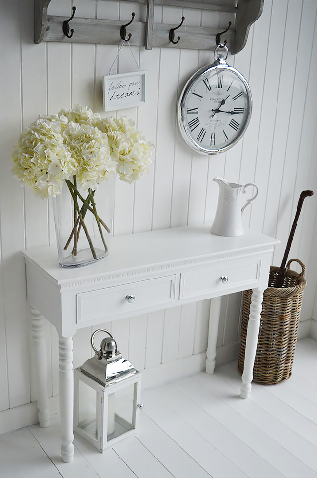 New England white and silver console table in white hall