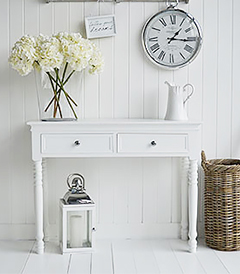 The New England Coast furniture, a white console table with drawers for beach style hallways