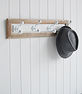 White and wood coat rack