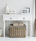 The New England narrow white console table for small hallway furniture with antique brass handles on the drawers. Suits all styles of homes from coastal to country
