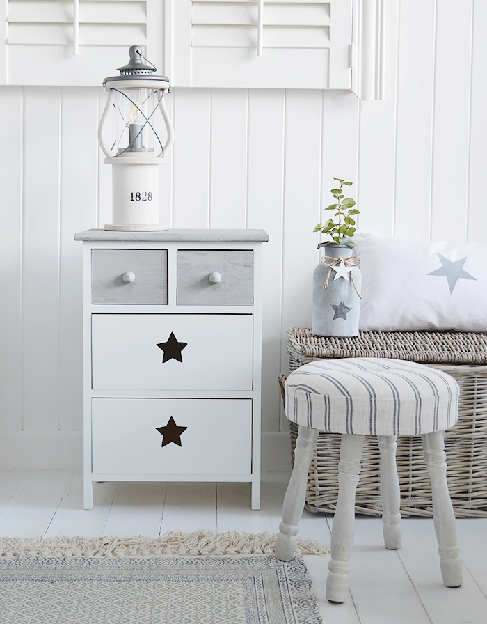 Plymouth wooden cabinet with four drawers in white and grey with cut out star decor from The White Lighthouse for hallway, bedroom and living room furniture. New England country, coastal and city white furniture