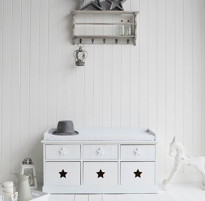 The Plymouth is a charming white storage bench . The three top dawers with star wooden handles offer storage for smaller items such as hats, gloves and scarves, while the three larger bottom drawers with a star cut out provide greater amounts of storage.