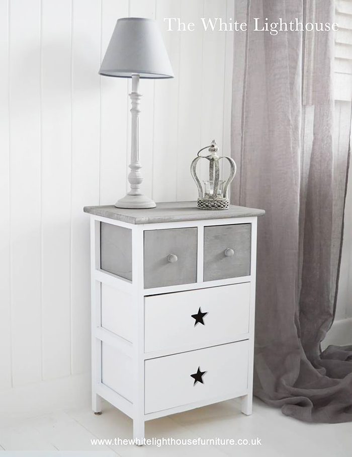 The Plymouth is a charming rustic white and grey wooden cabinet with four drawers. The two grey top dawers with knob wooden handles offer storage for small items while the two bottom drawers with a star cut out provide large amounts of storage.