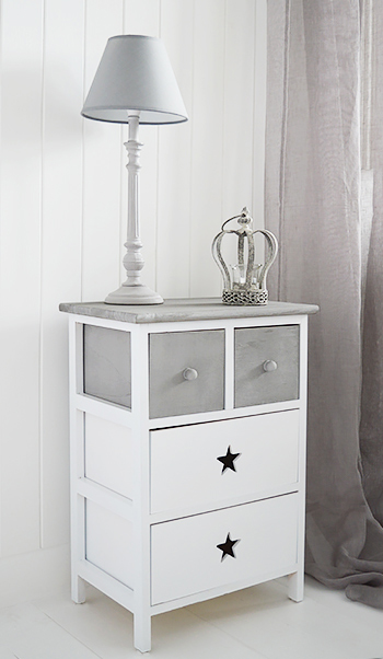 The Plymouth is a charming rustic white and grey wooden cabinet with four drawers. The two grey top dawers with knob wooden handles offer storage for small items while the two bottom drawers with a star cut out provide large amounts of storage in a white and grey hallway.