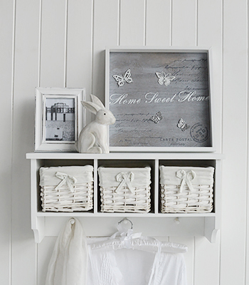 A White Wall Shelf With 3 Baskets And Hanging Pegs Hall