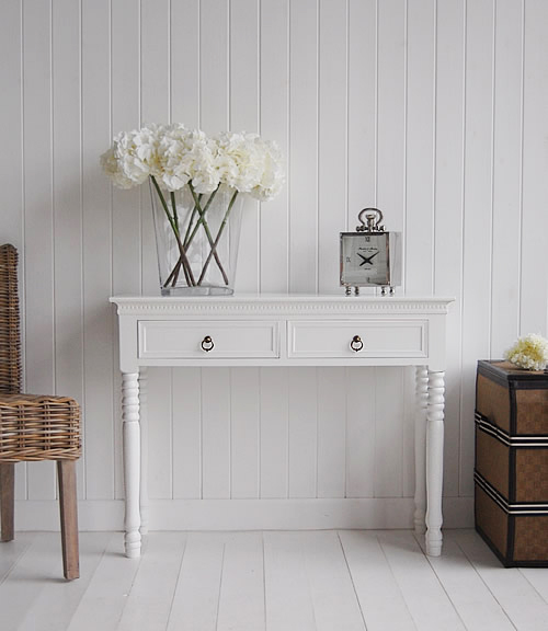 New England White console table with two drawers and antique brass handles for hall furniture. Simple and elegant interiors for beautiful homes from The White Lighthouse