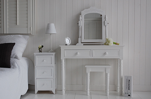A fantastic bedside table with the dressing table - a perfect white bedroom