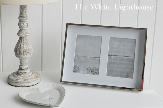 Decorate your console table with photographs for a homely feel.