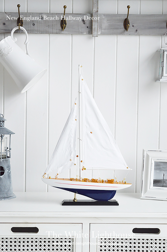 Decorate your New ENgland home with coastal accessories, warming woods and bright home decor