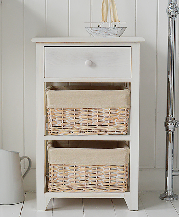 Cape Cod white wash bathroom storage furniture with baskets and drawer