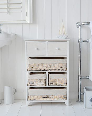 Cape Cod bathroom storage furniture with six drawers and baskets