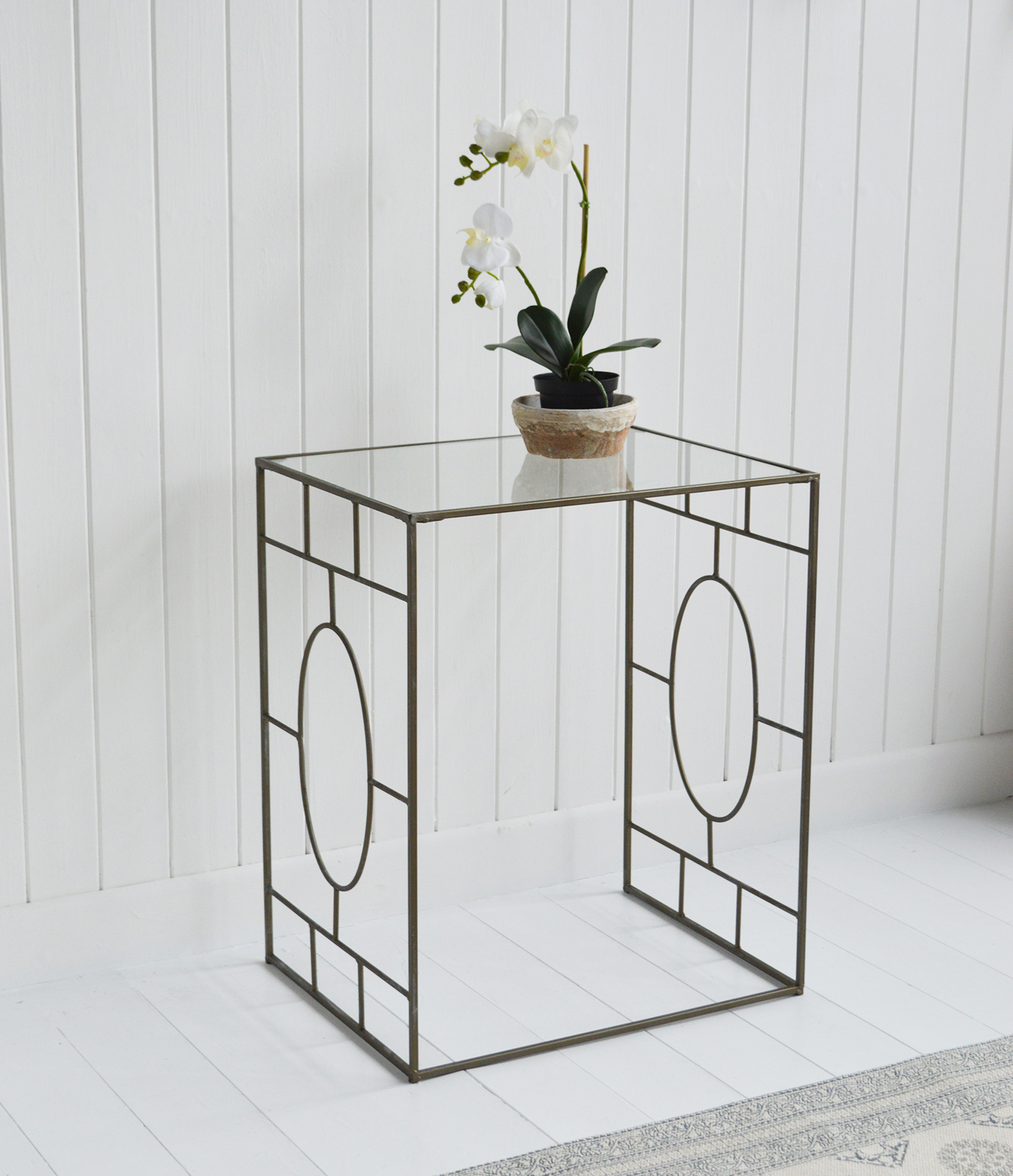 The Ascot side table.  In a gun metal silver finish and a glass top, this metal table offers impressive elegance as well as practicality.  Making a stunning centre piece of furniture as a bedside table in the bedroom, side or lamp table in the living room or hallway, all interiors will co-ordinate perfectly with this table.