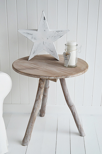 Driftwood round console for coastal style interiors