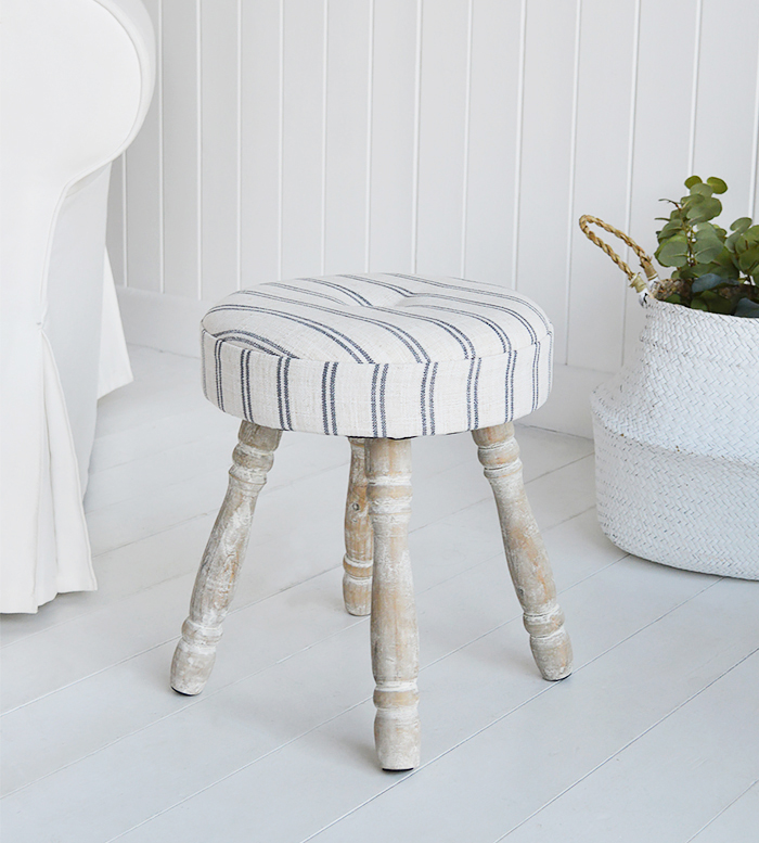 The Long Island small stool, padded and upholstered in ticking linen effect fabric with white washed turned legs.